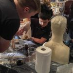 Pigeon Creek showing a child how to mix mould resin