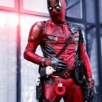 David Platts as Deadpool profile shot with fluffy cuffs and unicorn