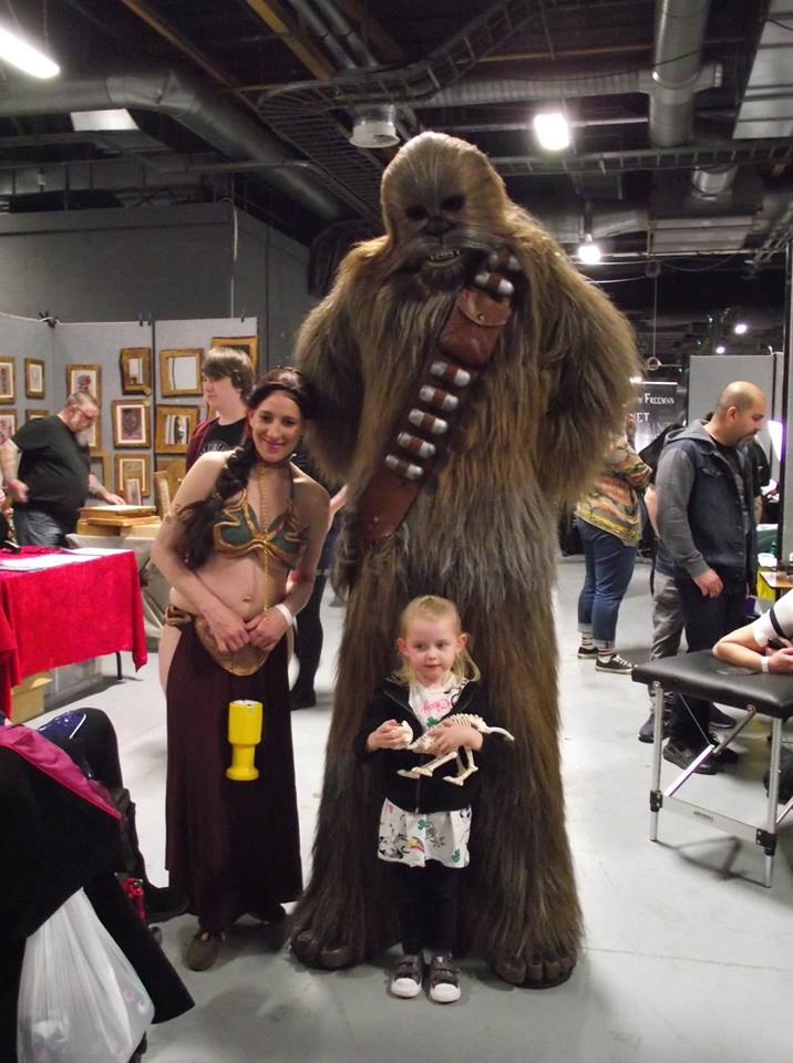 Leia and Wookie with small child