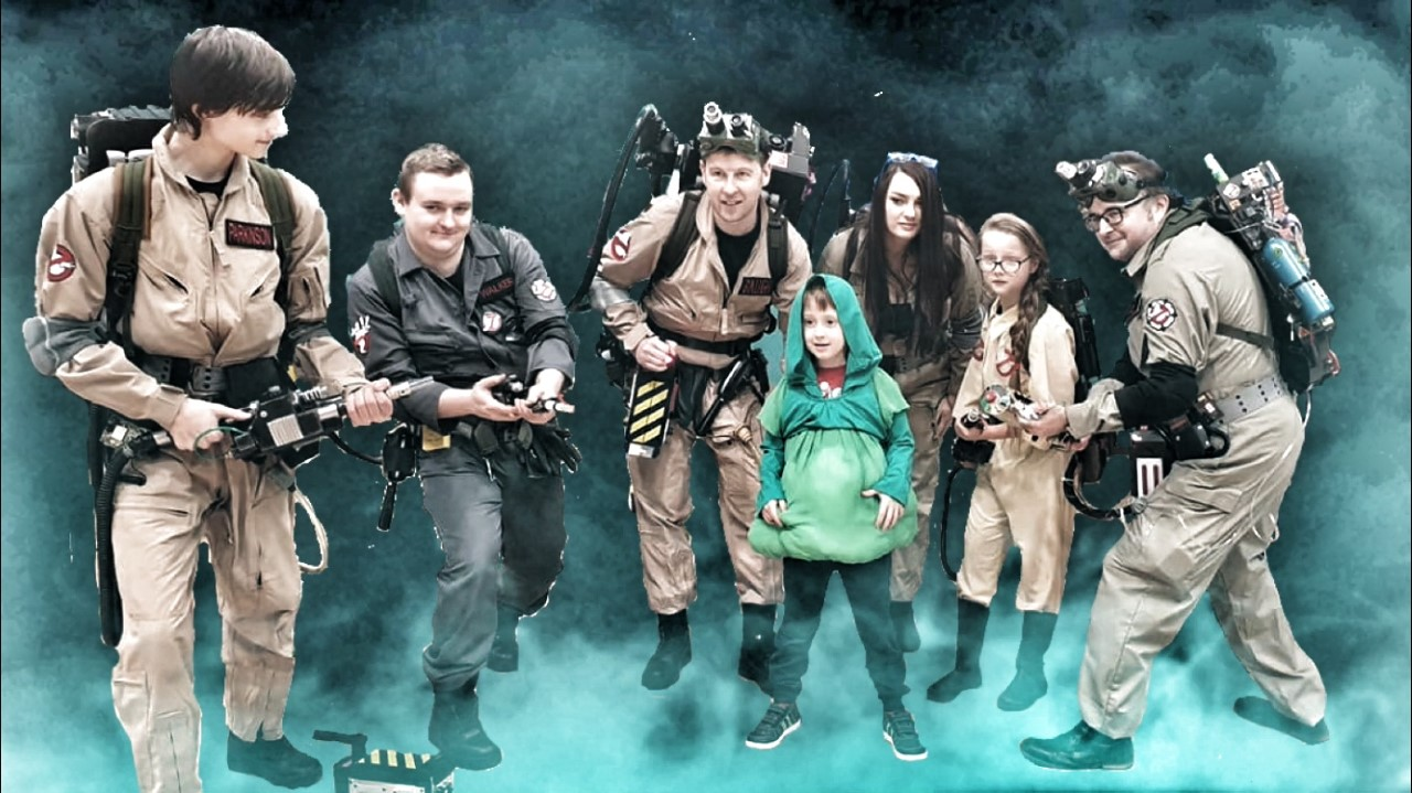 Group shot of the white rose ghostbusters with slimer